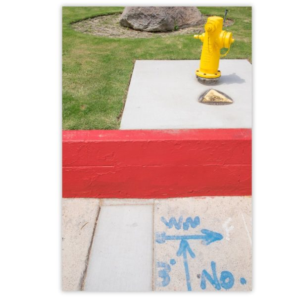 Yellow Hydrant over red plane and blue drawings