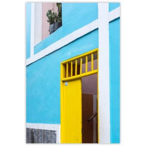 yellow door and light blue wall with pink