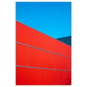 Red wall under blue sky